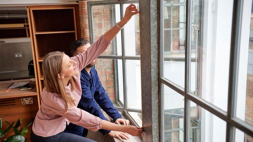 woman measuring window