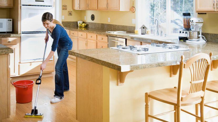 teen mopping floor