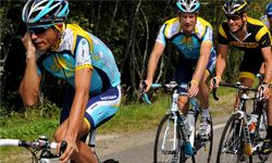 Alberto Contador (L) of Spain and team Astana looks like he might need a charger soon as he chats away while training during the 2009 Tour de France.
