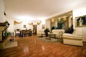 This living room and dining room combo is ideal for hosting parties. But the elegant white furniture and shiny wood floors are best suited to adults.