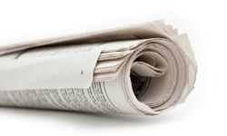 That lonely, days-old newspaper on your driveway is an invitation to a criminal.