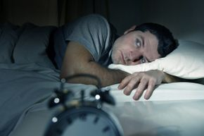 Man experiencing trouble falling asleep