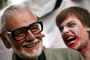 Watch out, Mr. Romero! That zombie's about to take a bite out of you at the 34th Toronto International Film Festival.
