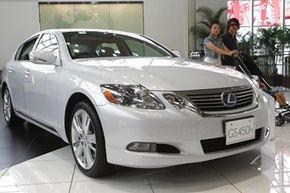 Visitors look at the Toyota Lexus GS 450h at a Toyota showroom in Tokyo, on July 1, 2010.