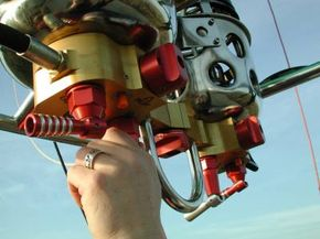 To blast the burner, the pilot opens the propane valve.