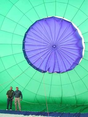 The parachute valve, from the inside of the balloon. A Kevlar cord runs from the valve at the top of the balloon, down to the basket, through the center of the envelope.
