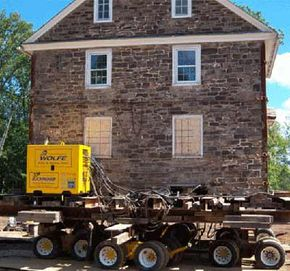 On the left is the jacking system that keeps the house level, while under the house are the steel beams and dollies that will take the house to its new home.