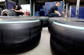 Red Bull technicians check race tires in preparation for the Formula One race at Albert Park in Melbourne, Australia.