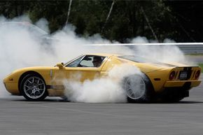 """Ari Strauss maneuvers his Ford GT on a """"skid pad"""" where drivers learn how to control a vehicle at Monticello Motor Club in Monticello, N.Y."""