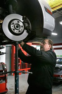 Mechanic Ed Wuerth works on a Volvo at his shop, Wuerth Automotive, in Brownstown Township, Mich.