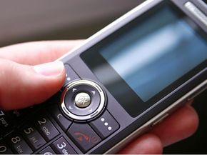 Most U.S. cell phone users have to buy a new phone if they switch to a different service provider, because the old phone is locked to the company that sold it. See more cell phone pictures.