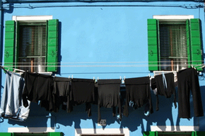 Line-drying your clothes may not be the most preferable way to keep your darks dark, but it'll work.