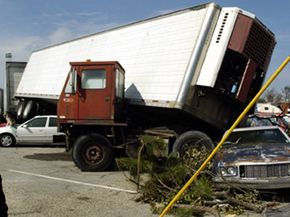 When a driver loses control of a large rig, like Hurricane Katrina caused here, the vehicle can jackknife, or fold into itself. Roy Causey inspects his car that was crushed by a tractor-trailer, after being hit by Hurricane Katrina in Biloxi, Mississippi. See more truck pictures.