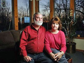 Julie Amero, right, and her husband Wes Volle sit in their living room Feb. 7, 2007. Spyware forced a computer to show pornography in the classroom where she was substitute teaching, costing Amero her job.