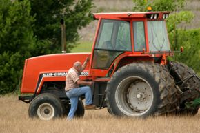 Farmer Mel Babbert, age 75, climbs into his tractor on land he farms near Canal Winchester, Ohio.