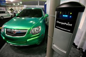 A Saturn Vue plug-in hybrid vehicle is shown with a Smartlet charging station at the Coulomb Technologies exhibit at the Plug-In 2008 conference on plug-in hybrid vehicles in San Jose, Calif.