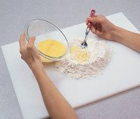 Gradually add the mixture to the                    flour to make a ball of dough.