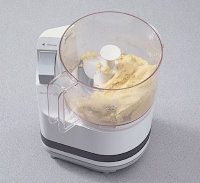 Combine pasta mixture in a food                    processor and run until                    the dough forms a ball.