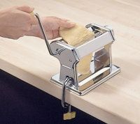 Knead the dough through the pasta                    machine at the widest setting.