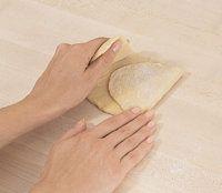 Fold the pasta dough into thirds.
