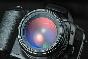 When it comes to cleaning your lens, less is more. Constantly cleaning the lens may actually cause more problems that it solves -- a small amount of dust rarely affects image quality.