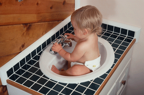 You can use the sink to clean a dirty diaper if you want, but we suggest taking them off the baby first.