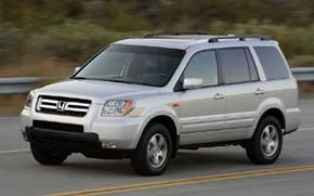 The lease price and the purchase price of the 2006 Honda Pilot EX AWD are the same -- $33,595 -- but that's where the similarities end.
