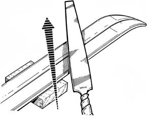 File the ski bottoms flat using even diagonal strokes; work from the boot area toward the tip and then back. Treat only the center section of each ski; leave the tips and the tails unfiled.