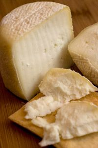 It only takes basic equipment and ingredients to produce a simple wheel of cheese.