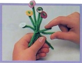 Slip stems through button holes and glue.