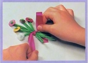 Gather stems and tie a ribbon.