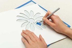 To repair a paper stencil, use tape and a craft knife.