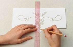 Measure and mark the center of the stencil.