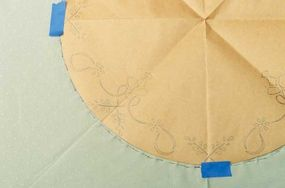 Outline the edge of the circle with a chalk pencil or straight pins.