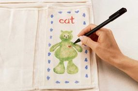 Stencil a heart on each animal with a 1/4-inch brush.