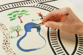 Paint the table to add lakes, trees, and other natural elements.