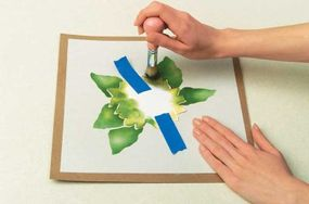 Cover the flower while you paint the leaves.