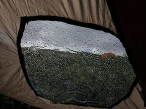 A rain-soaked tent on the bank of the Kokalik River in Alaska. Lying downinside your tent during a lightning storm is not the safest option.