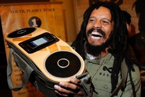 Bob Marley's son Rohan holds up a set of speakers sold under the Marley family name.