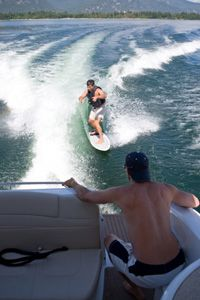 Image Gallery: Surfing Wakesurfers surf in the wake behind boats. See more pictures of surfing.