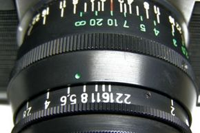 Aperture numbers are typically shown right on the body of a lens. Most digital cameras also display the aperture number on the LCD screen.