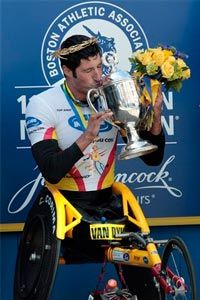 Men's wheelchair winner Ernst Van Dyk of South Africa kisses his trophy in Boston after the 114th running of the Boston Marathon Monday, April 19, 2010.