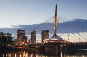 Manitoba, Canada's Esplanade Riel pedestrian bridge, competed in 2003, spans the Red River.