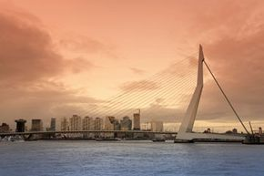 Holland's Erasmus Bridge resembles a harp with its cable-stayed construction.