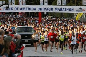 Runners take off from the starting point of the Chicago Marathon in Chicago, Sunday, Oct. 11, 2009.