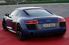 The mid-engine, all-wheel-drive, 2014 Audi R8 V-10 plus -- a supercar that simply begs to be driven fast.