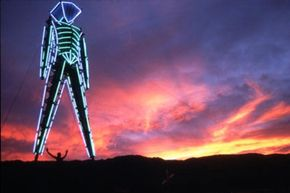 The forty-foot sculpture of the Burning Man stands wrapped in EL wire at the Twelfth Annual Burning Man Festival in Nevada.