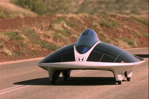 The Honda Dream solar car races through Australia as part of the World Solar Challenge.