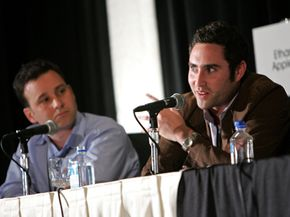 Director of business development for Imeem Ethan Applen (L) and president and co-CEO of special ops media Jason Klein speak during the Broadband Video Revolution Panel Discussion at the American Film Market.