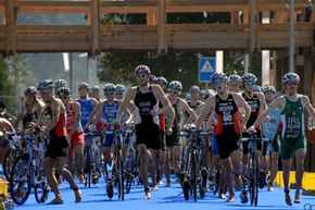 Triathletes compete in the cycling portion of the 2010 Lausanne ITU Elite Sprint Triathlon World Championships.